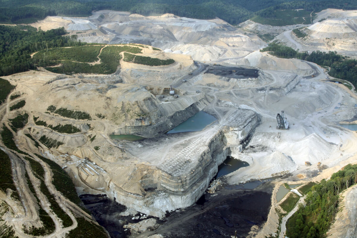 """mountaintop removal This time-series of images of a surface mine in boone county, west virginia,  illustrates why this controversial mining method is also called """"mountaintop  removal."""